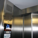 Dettaglio su indicatore piano ascensore realizzato a Milano - 1